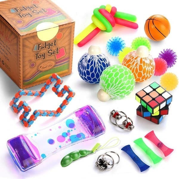 The box of fidget toys with various toys that come with it outside the box