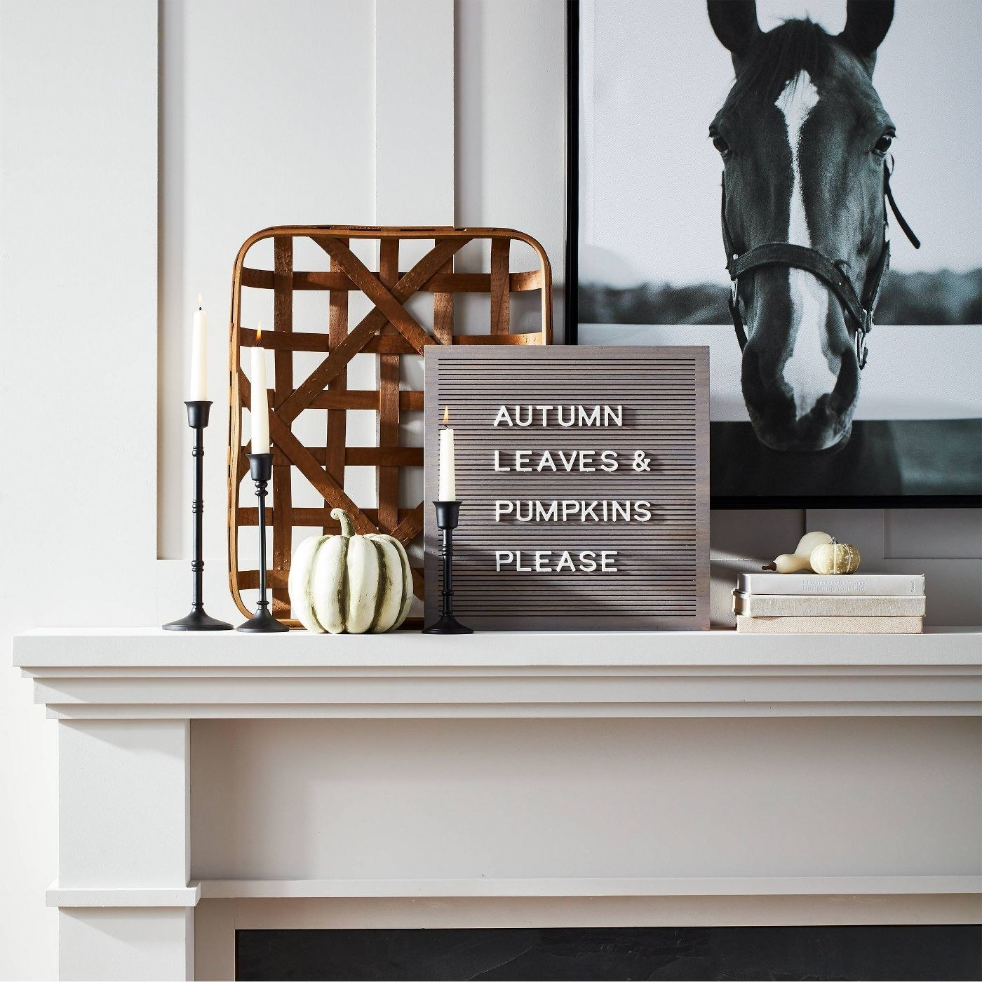 wooden letterboard on a mantle