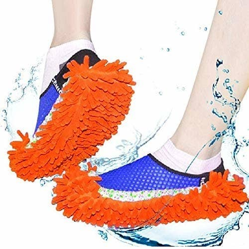 Person wearing microfiber mop slippers over their sneakers.