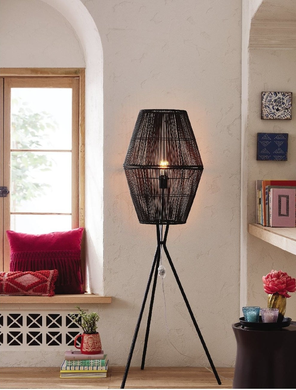 black floor lamp with a caged lampshade