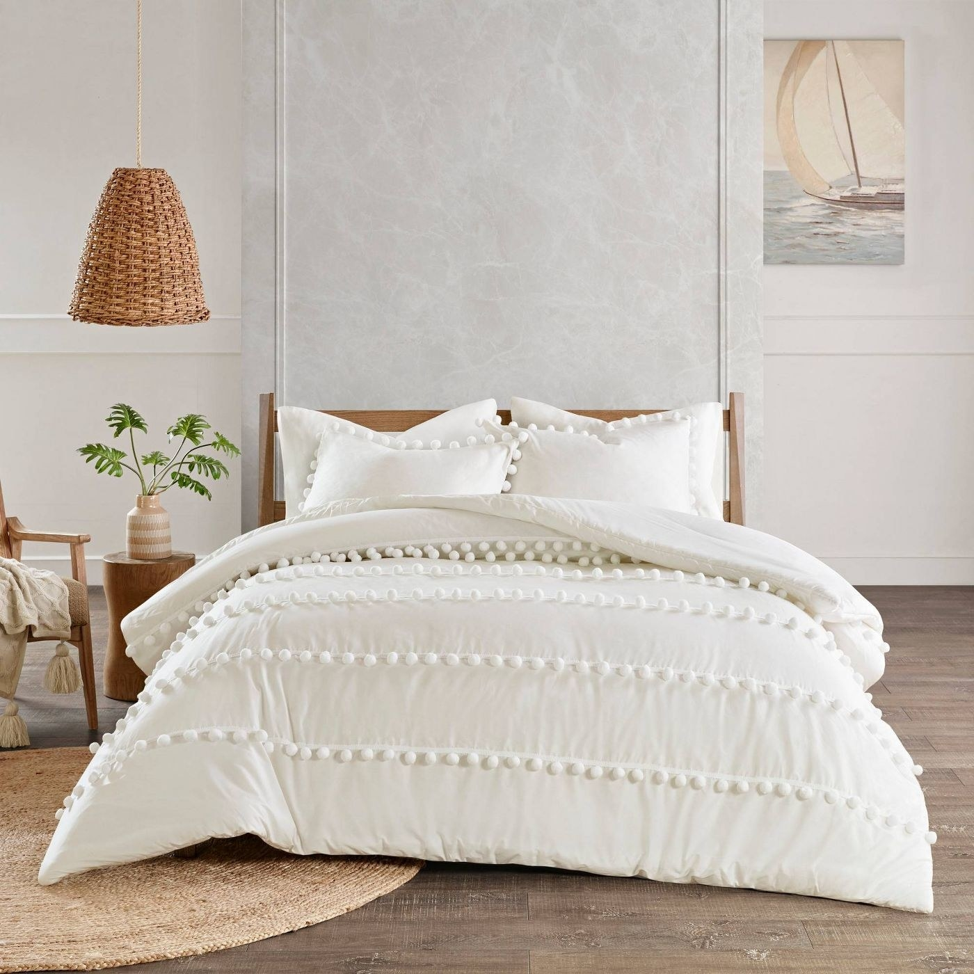 ivory duvet cover with pom pom details and two pillow shaws