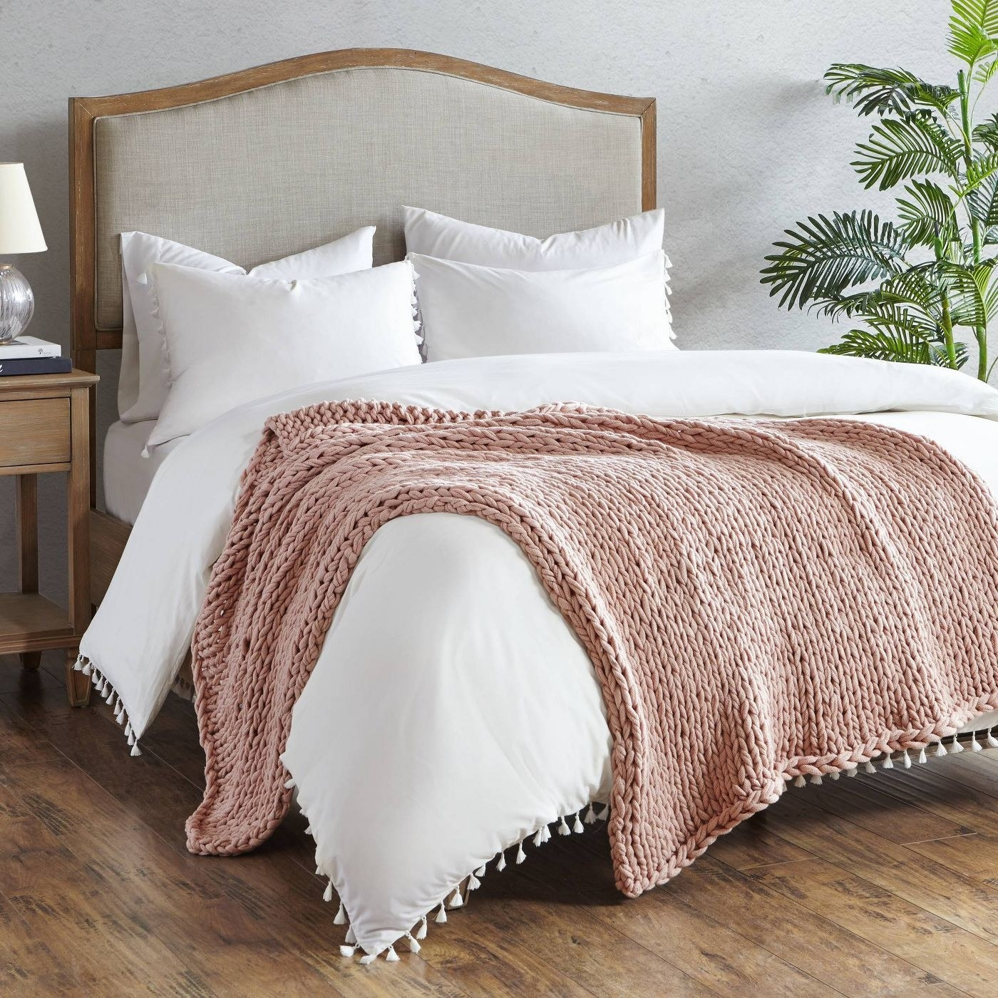 blush chunky knit throw blanket on a bed