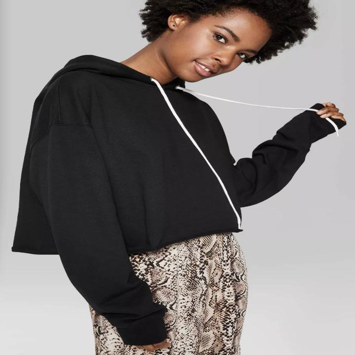 model wearing the cropped hoodie in black