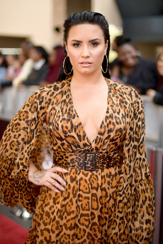 Demi wearing an animal print dress