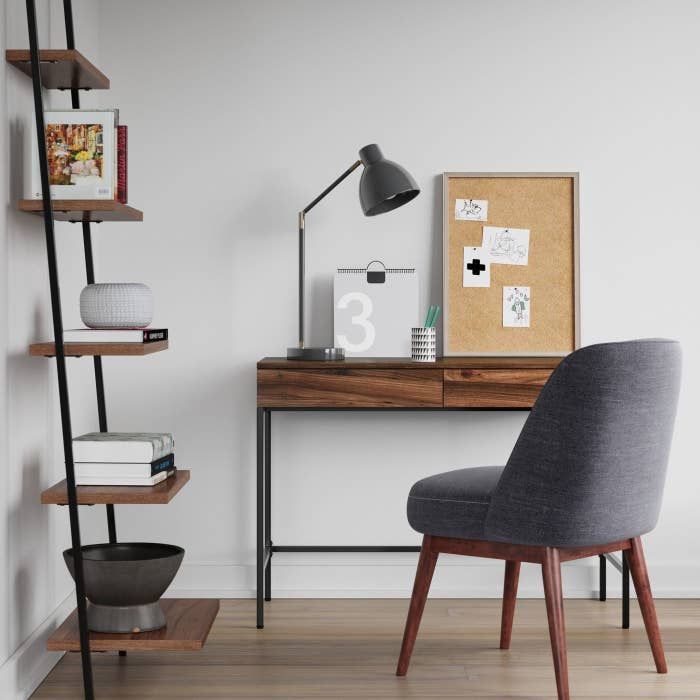 wooden desk with black metal legs in a home office