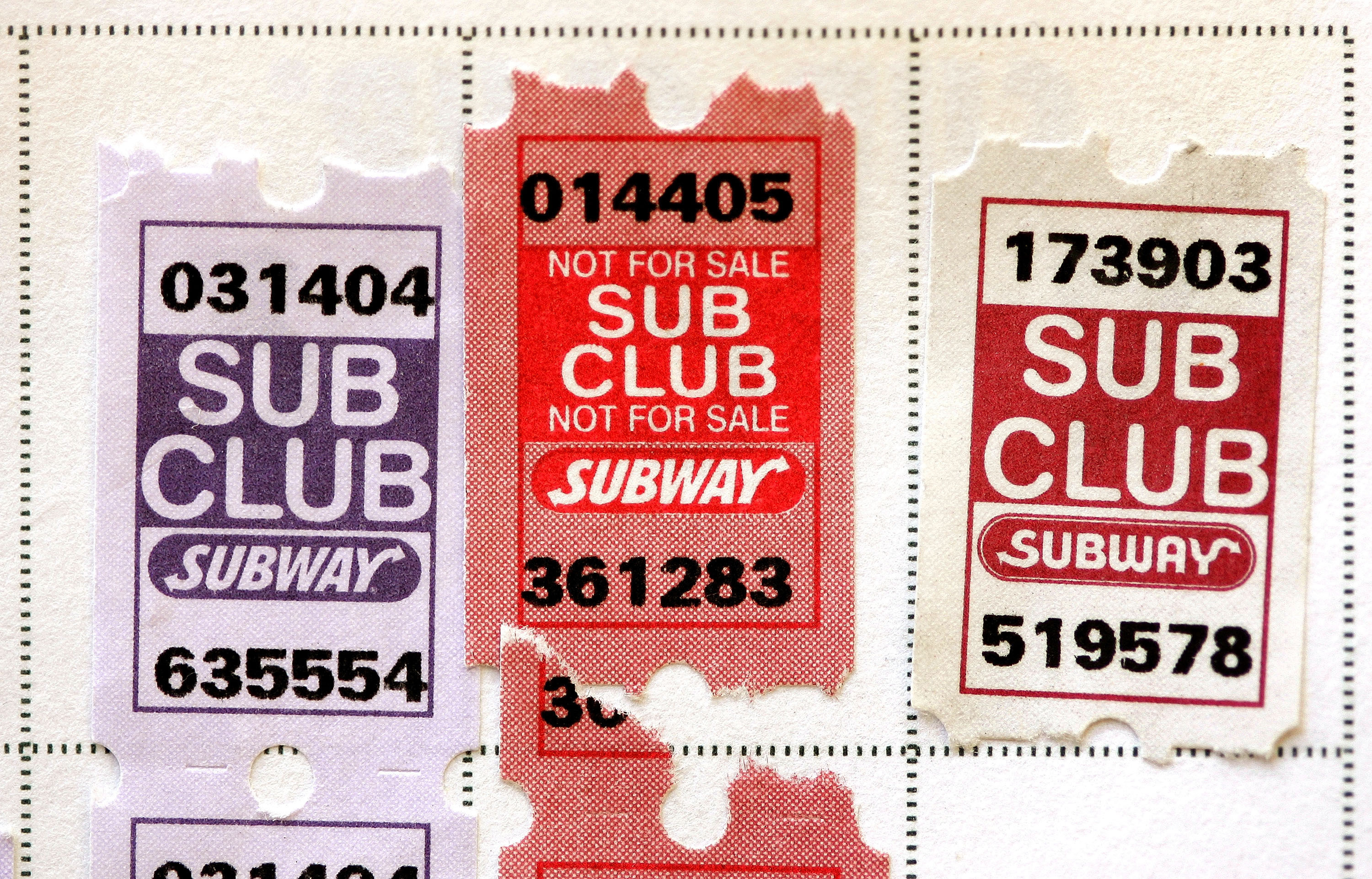 A close-up photo of Subway's Sub Club stamps