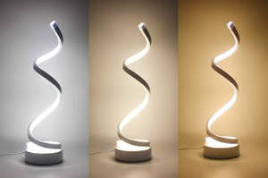 A spiral LED desk lamp that can light up with different shades of warmth