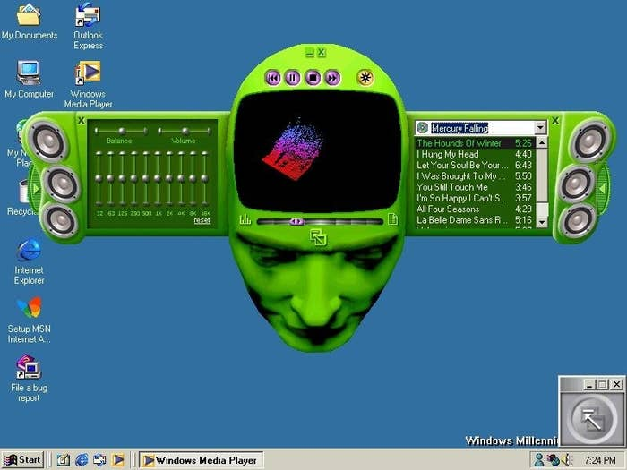"""A Windows Media player overlaid with the """"skin"""" of a green human head"""