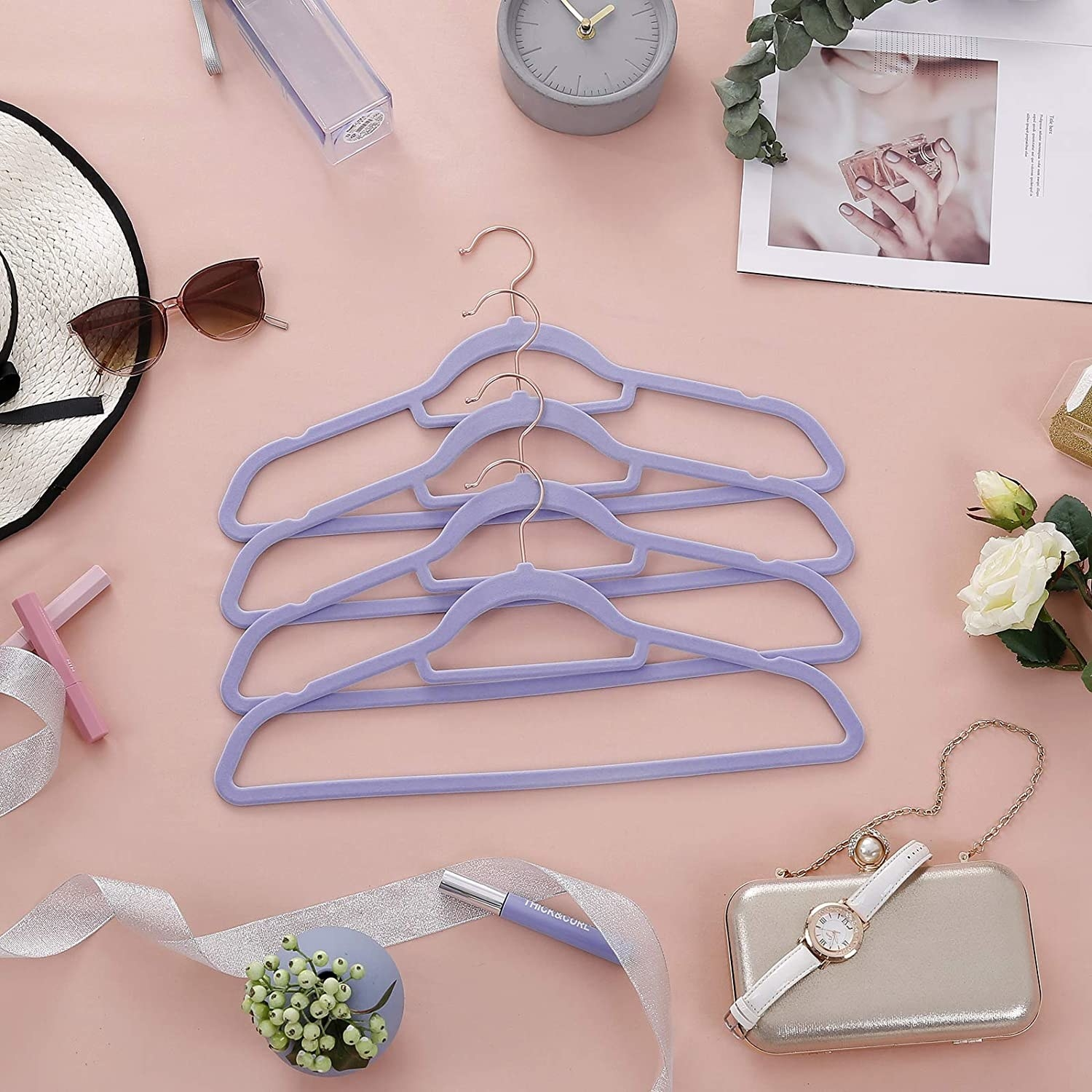 Purple velvet hangers laid out on a table