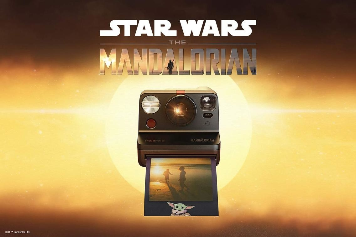 the camera with the mandalorian logo on it and a picture with a baby yoda frame around it