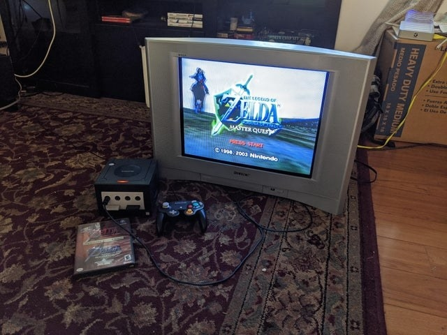 A early 2000s direct view TV with a flat front and playing Zelda Master Quest on the Game Cube