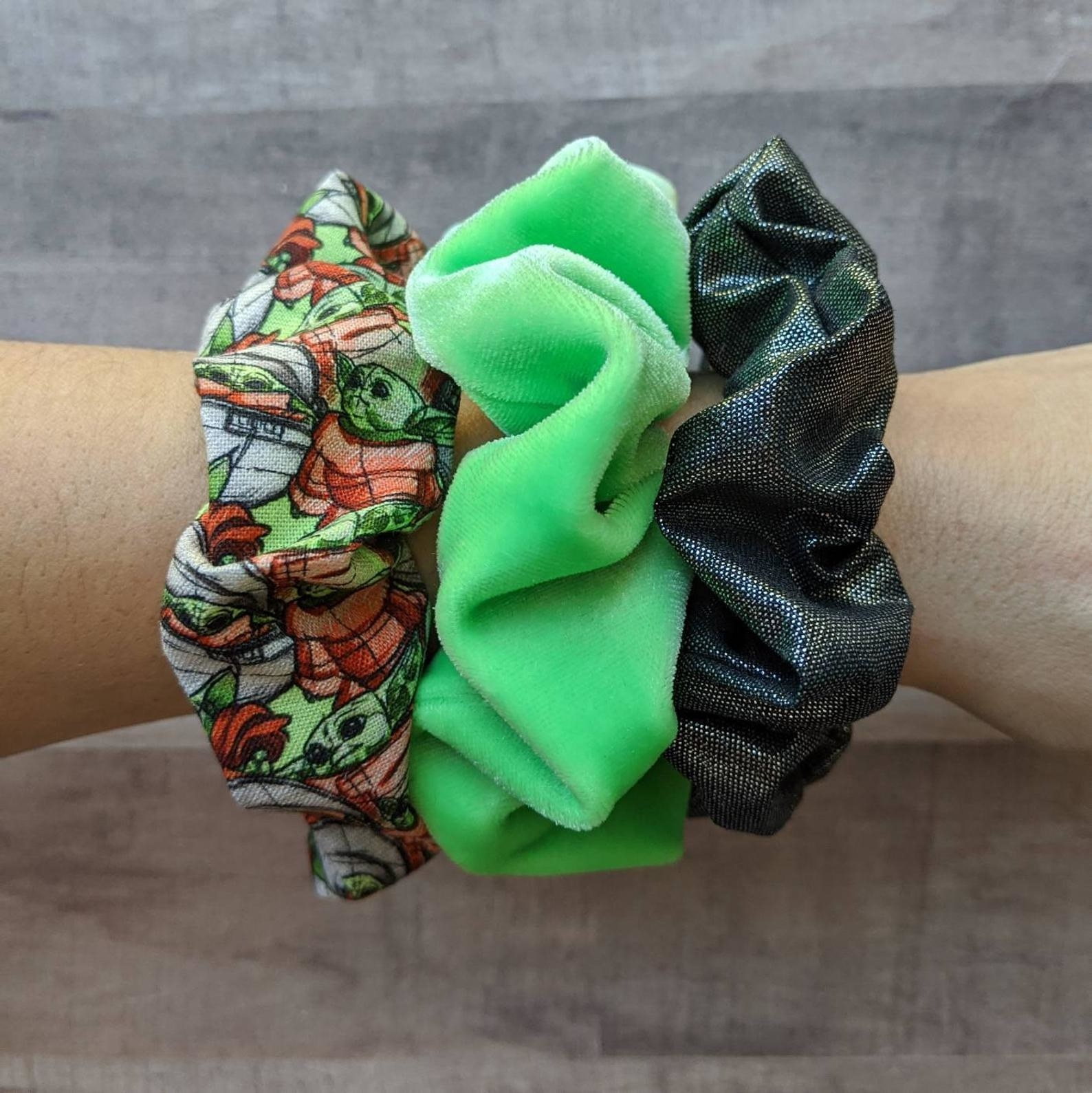 three scrunchies on arm