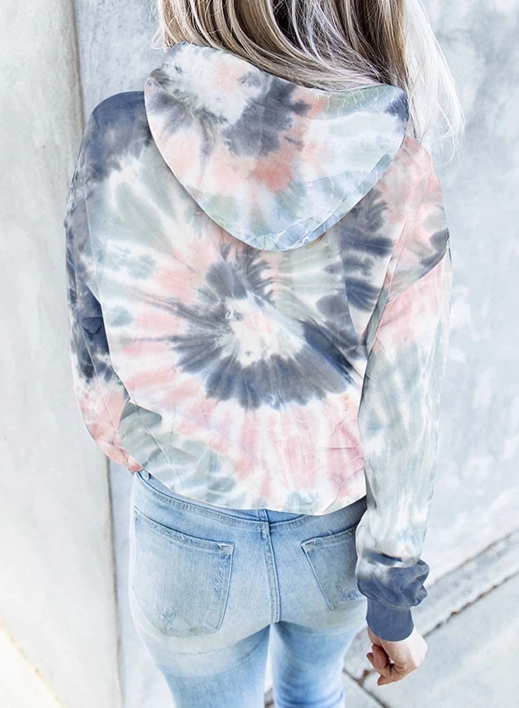 model wearing the hoodie in pink and blue tie dye