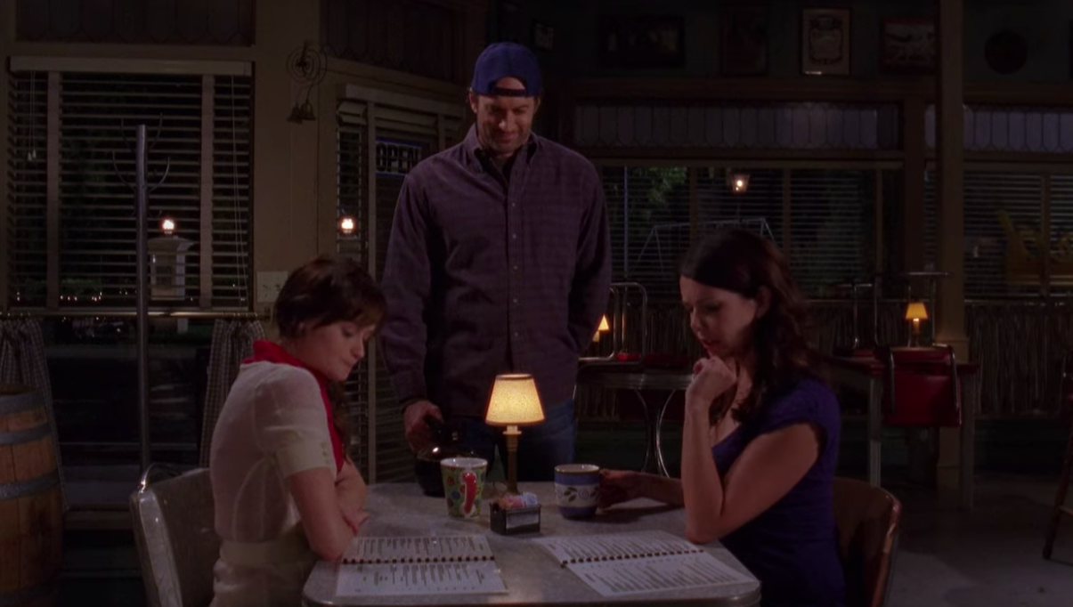 Luke serves Rory and Lorelai at the diner in the final scene