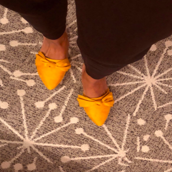 Reviewer wears same style mule with black wide leg pants