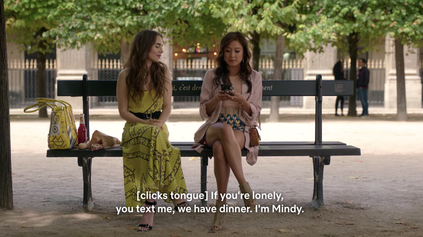 Mindy taking Emily's phone and giving her her phone number.