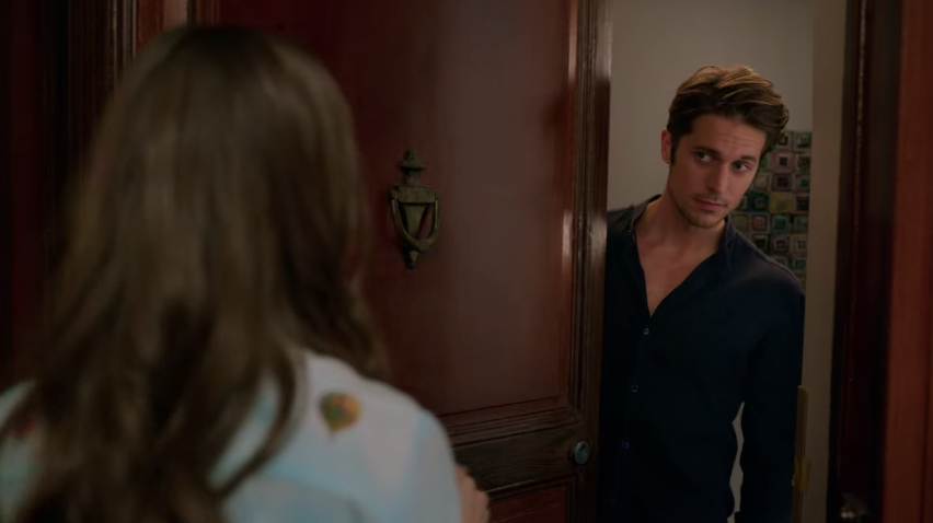 Gabriel opening his door to find a surprised Emily trying to get into his apartment.