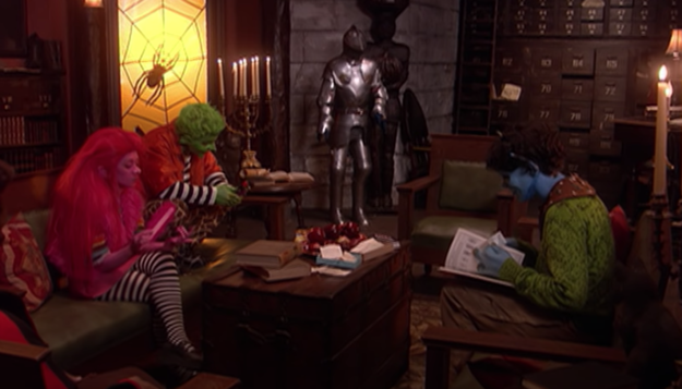 Halloweentown High monster teens sit around the living room reading books