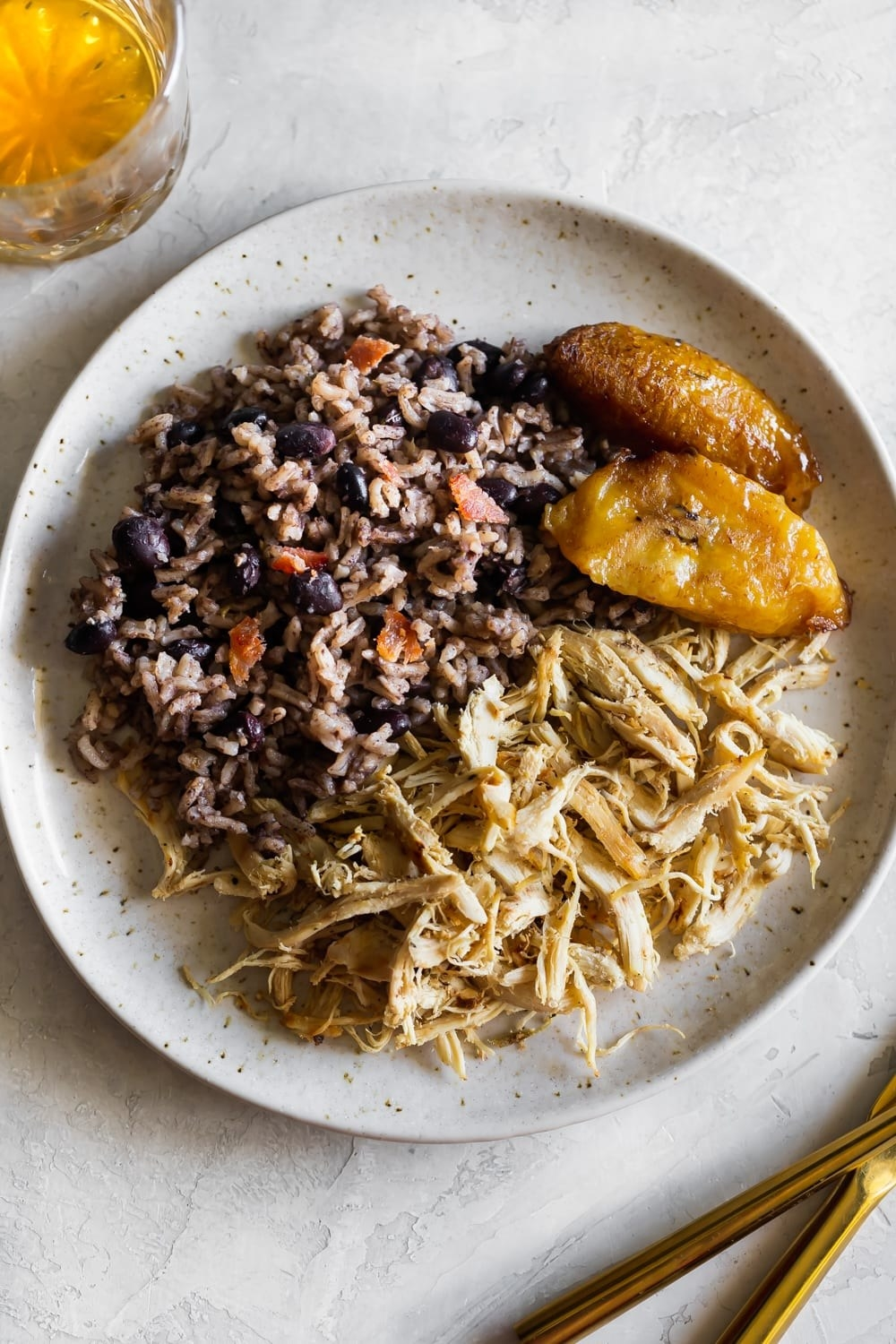 A plate of arroz congri with a side of plantains.
