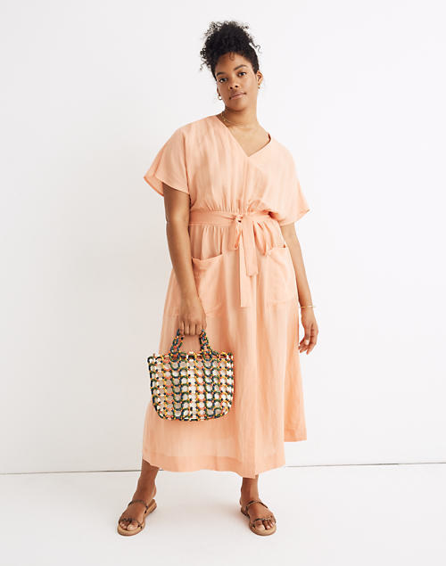 Loose dress with front pockets and front tie