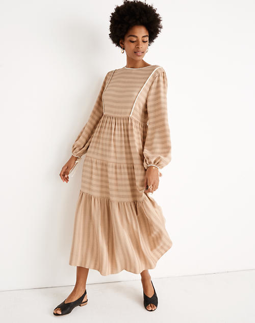 Prairie dress in tan with long sleeves and ruched bottom