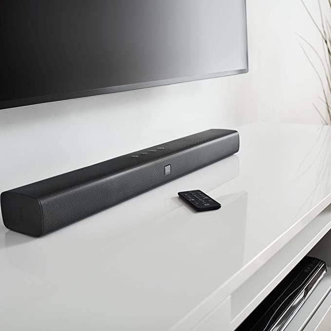 Sleep black rectangular sound bar.