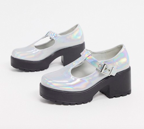 Holographic Mary Jane platform shoes with a black sole and heel and an iridescent upper with a buckle