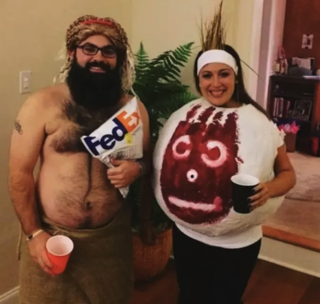 "A couple dressed as Tom Hanks' character and Wilson the volleyball from ""Cast Away"""