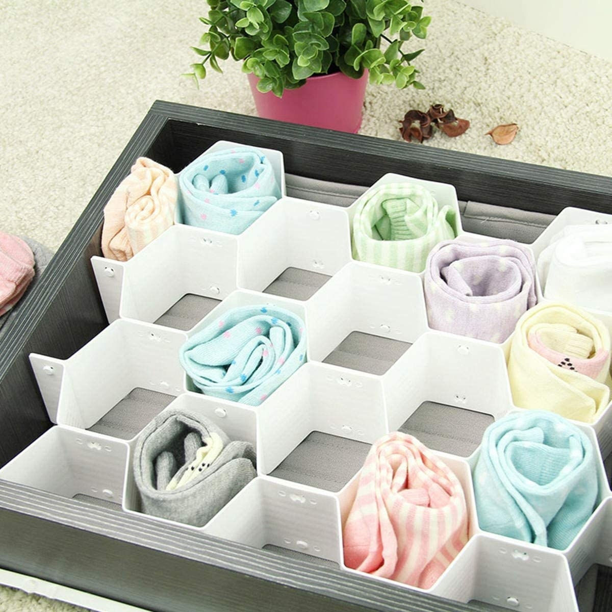 Several pairs socks in a honeycomb organizer