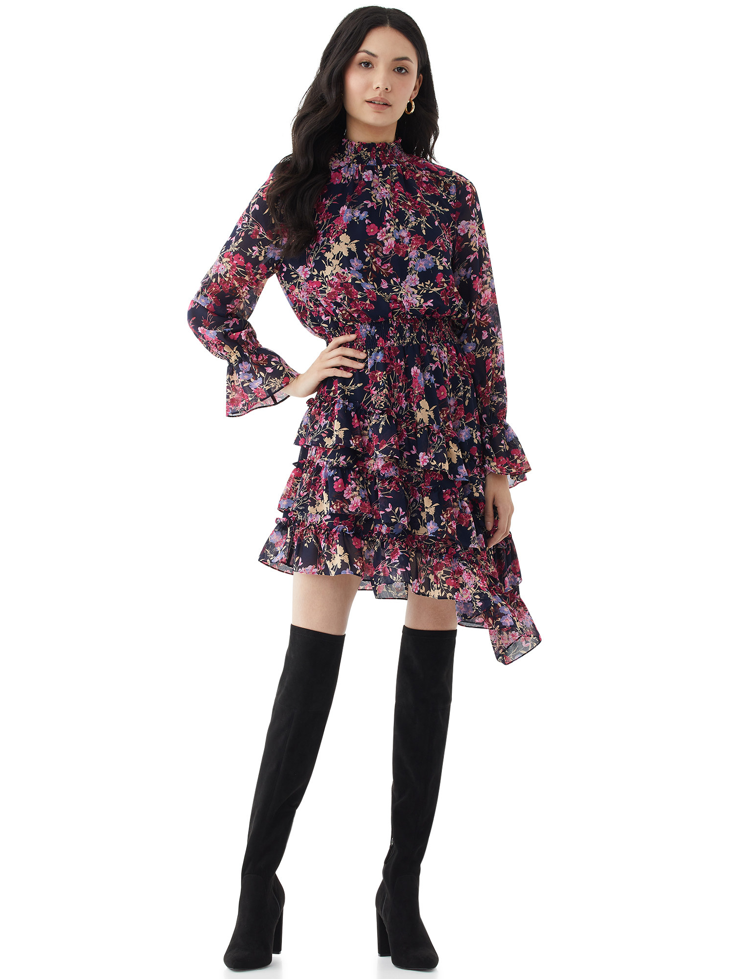 Model in asymmetrical floral dress