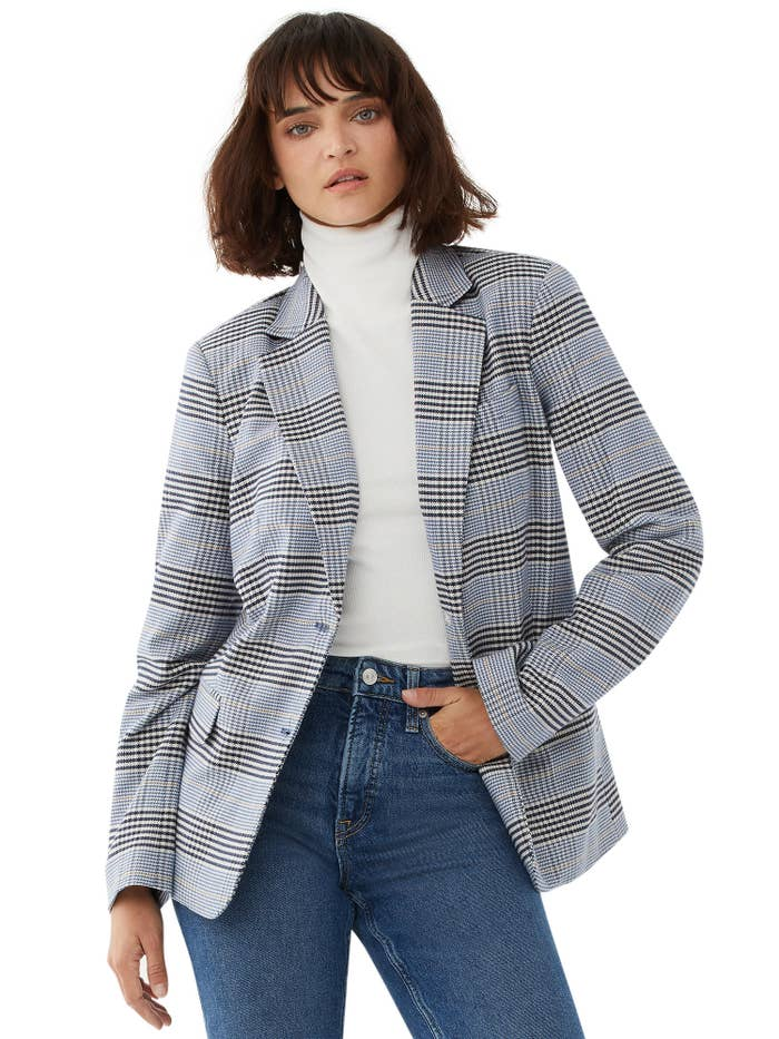 Model in plaid blazer and jeans