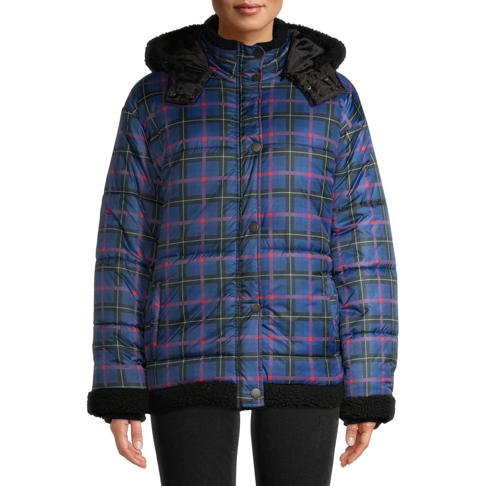 Model in plaid puffer jacket