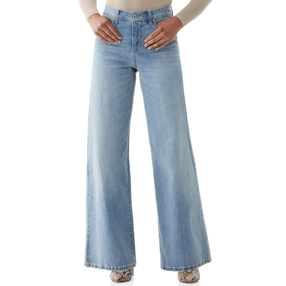 Model in super wide leg jeans