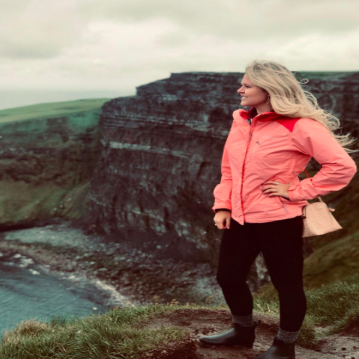 Reviewer wears same rain boots while walking along cliffs in Ireland