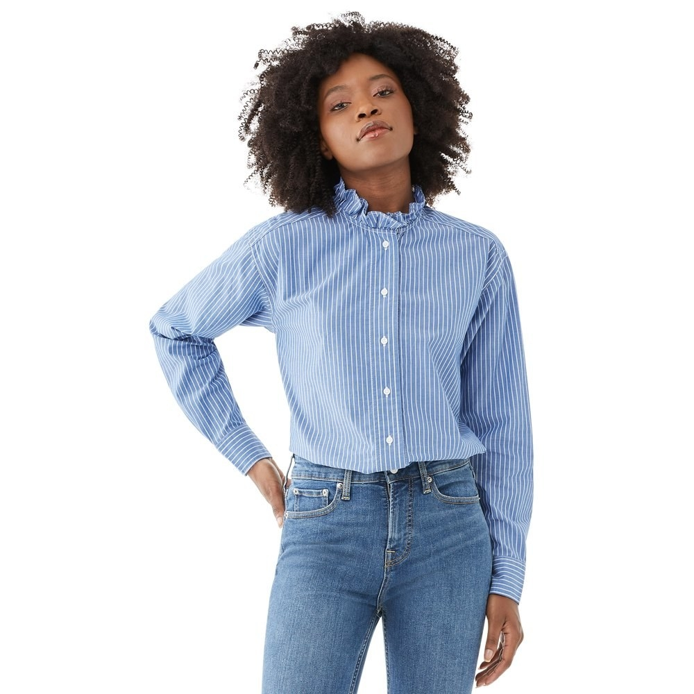 Model in ruffled blouse and jeans