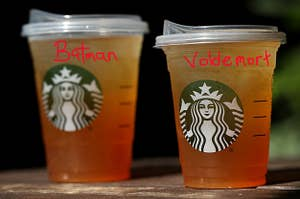 Two Starbucks drinks with the names Batman and Voldemort written on them