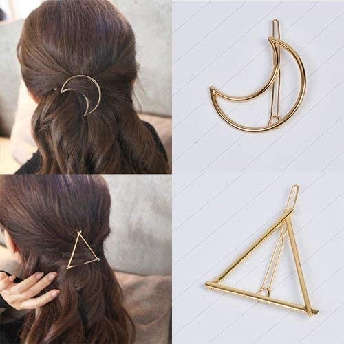 A set of clips in a persons hair