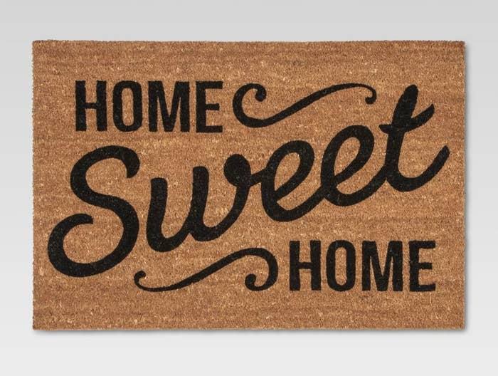 "Brown doormat with the words ""Home Sweet Home"" written across"