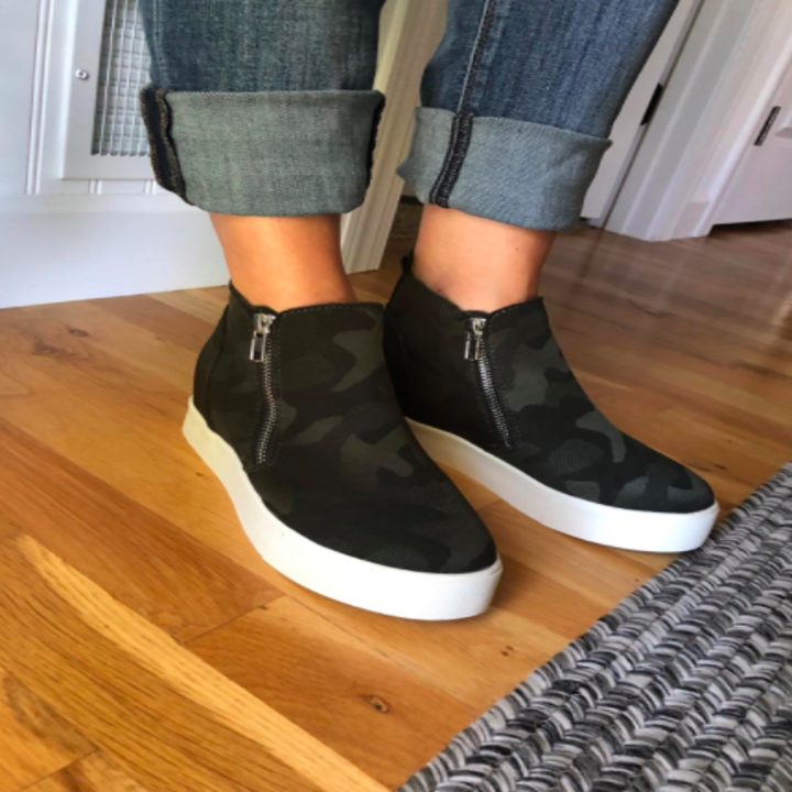 Reviewer wears camo-print platform sneakers with cuffed denim