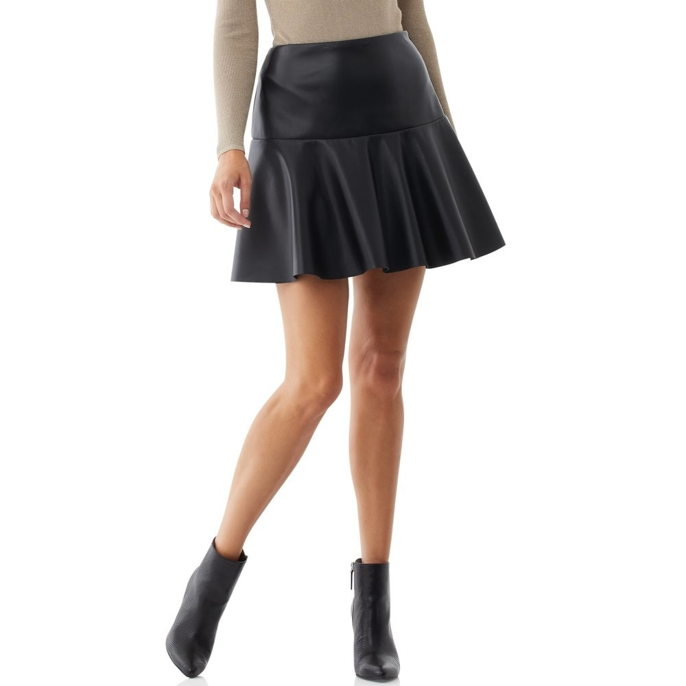 Model in vegan leather skirt and booties