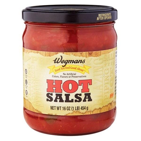 A jar of Wegmans brand hot salsa.