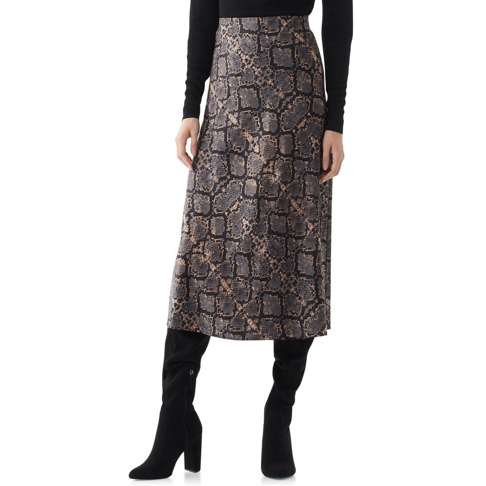 Model in midi slip skirt in a black python print
