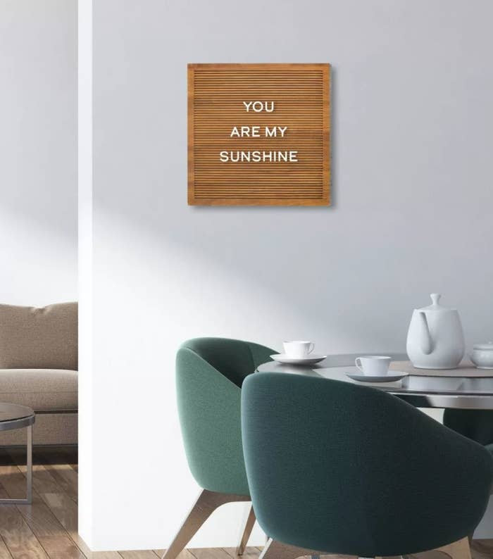 """A brown wood-look letter board with white letters spelling """"You are my sunshine"""""""