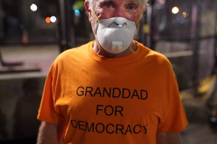 An older man wearing a face mask