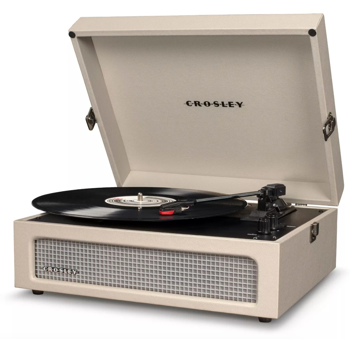 A turntable with a beige/white case playing a record