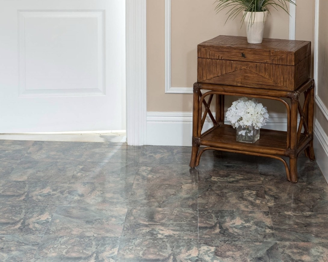A room in a home with peel and stick dark slate marble tiles on the floor