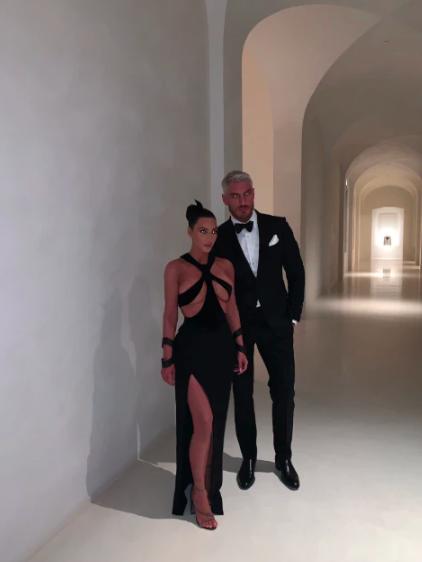 Kim Kardashian standing in her scary mansion