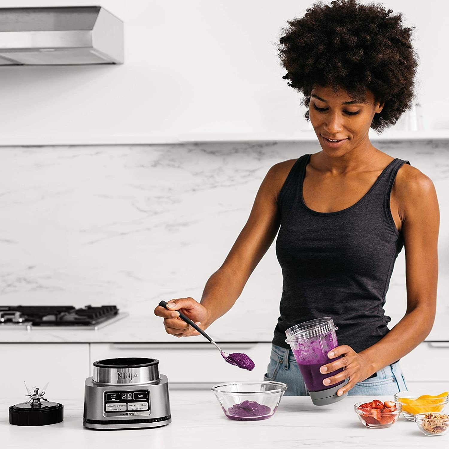 model spoons out thick acai from bottle