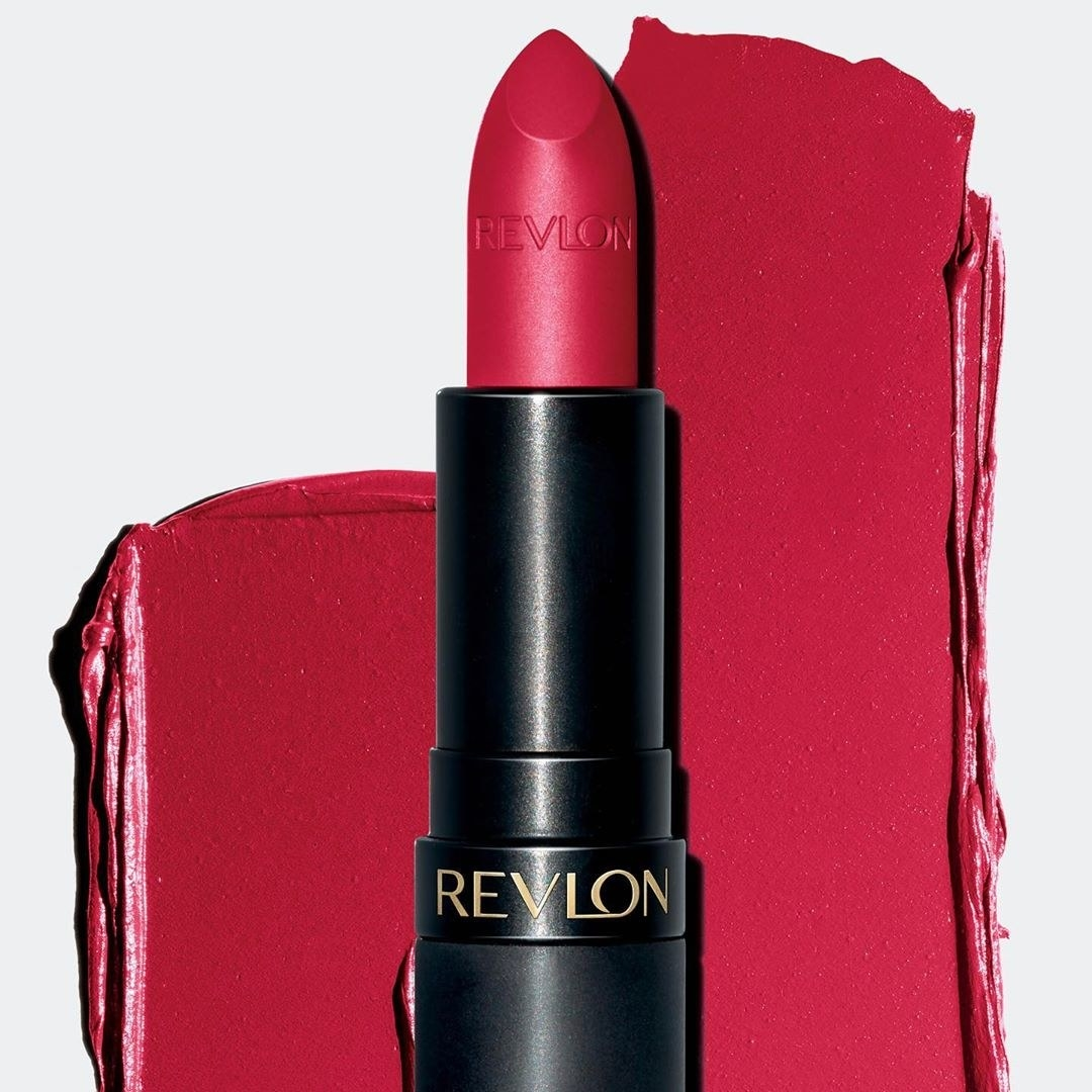 Revlon lipstick with red lipstick smeared in the background