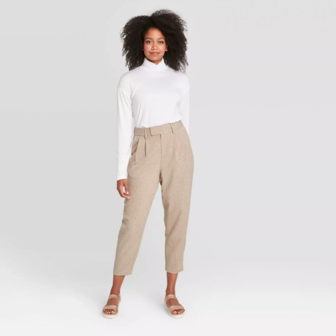 Model wearing beige tapered pants